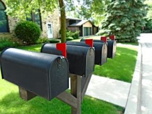 Four black mailboxes