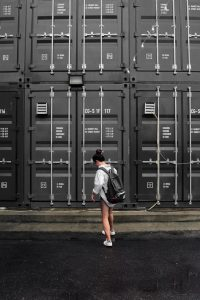 girl in front of a storage container